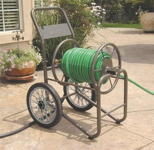 Garden Hose Storage Ideas the decorative coiled hose garden storage beckons you to pause and sit awhile in the garden Industrial Grade Garden Hose Reel Cart