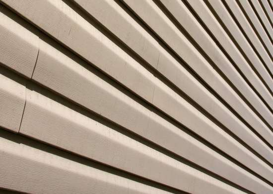 Warped-house-siding