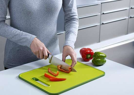 Cutting board with knife sharpener