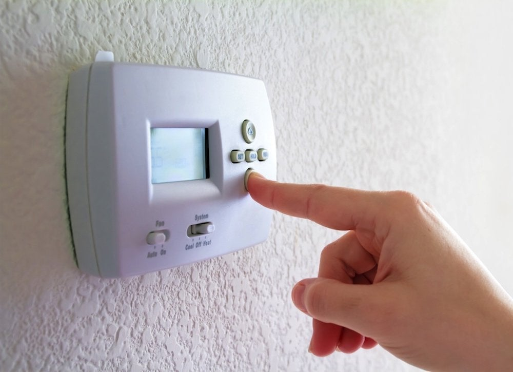 Programmable thermostat adjustment