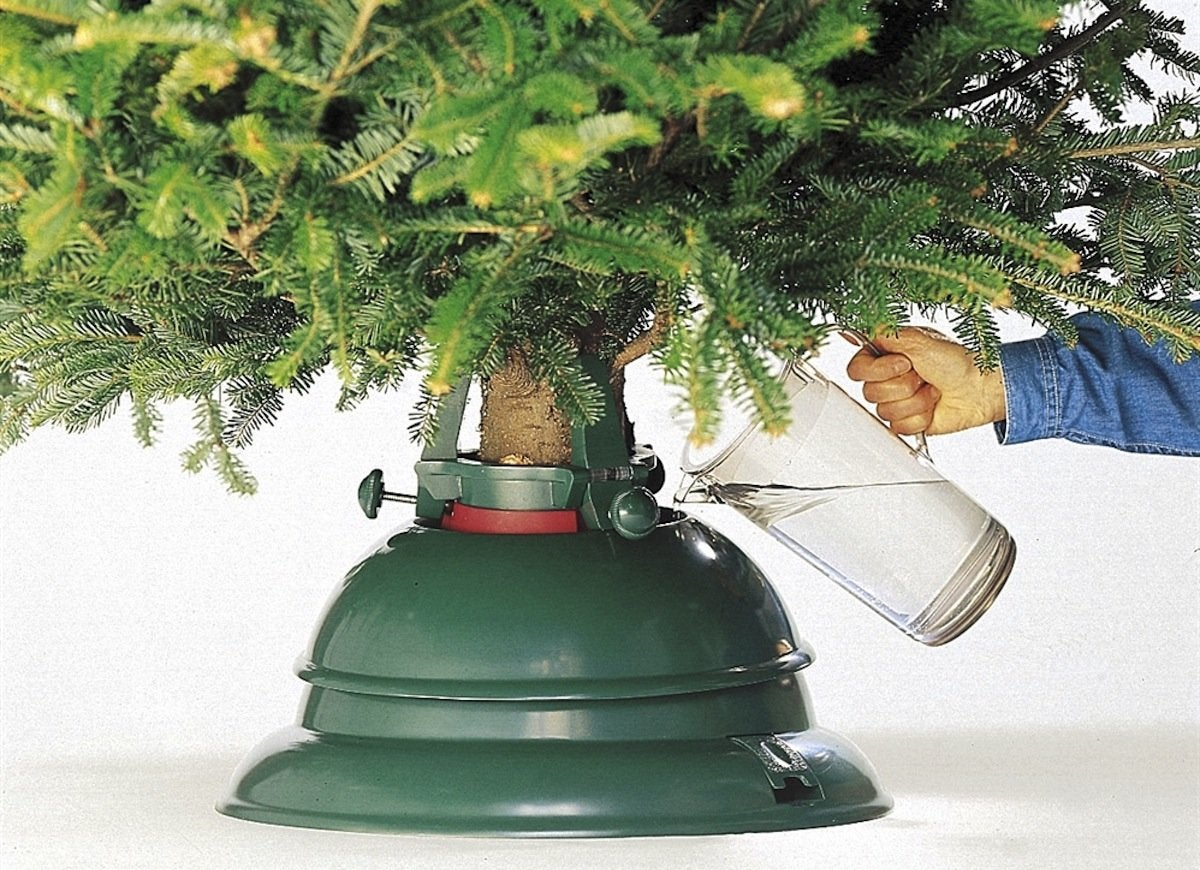 Place A Sheet Of Plastic With A Towel On Top Of It Under The Christmas Tree  Stand Prior To Setting It Up. If You Have A Watering Snafu, Or The Tree  Stand ...