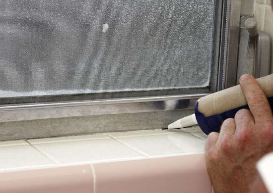 Caulk bathroom window