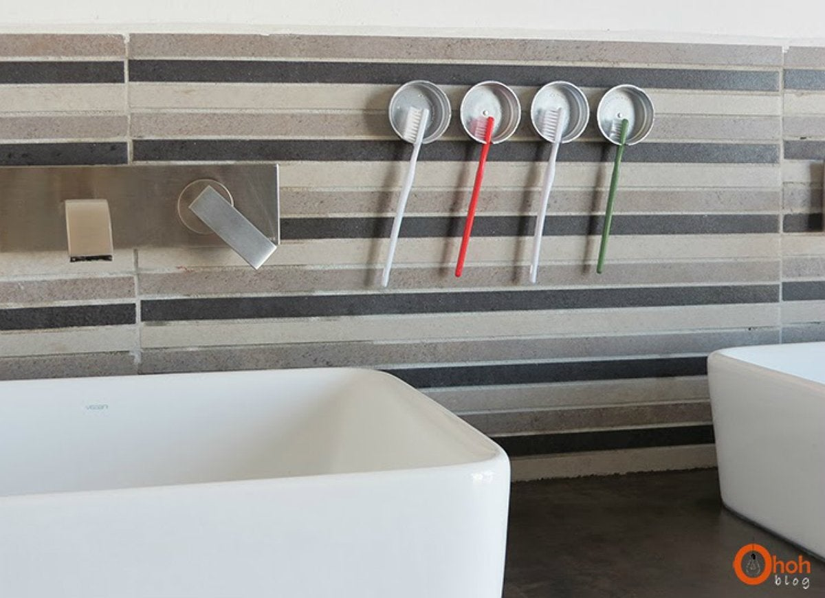 Store your toothbrushes with jar lids diy storage 18 for Best way to store toothbrush in bathroom