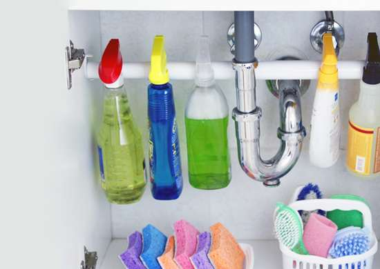 Organize Under the Sink with Tension Rods