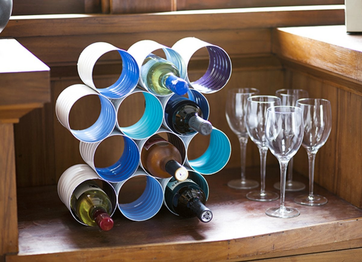 Diy this wine rack from coffee cans diy storage 18 clever solutions you can make for free - Riciclare tutto in casa ...
