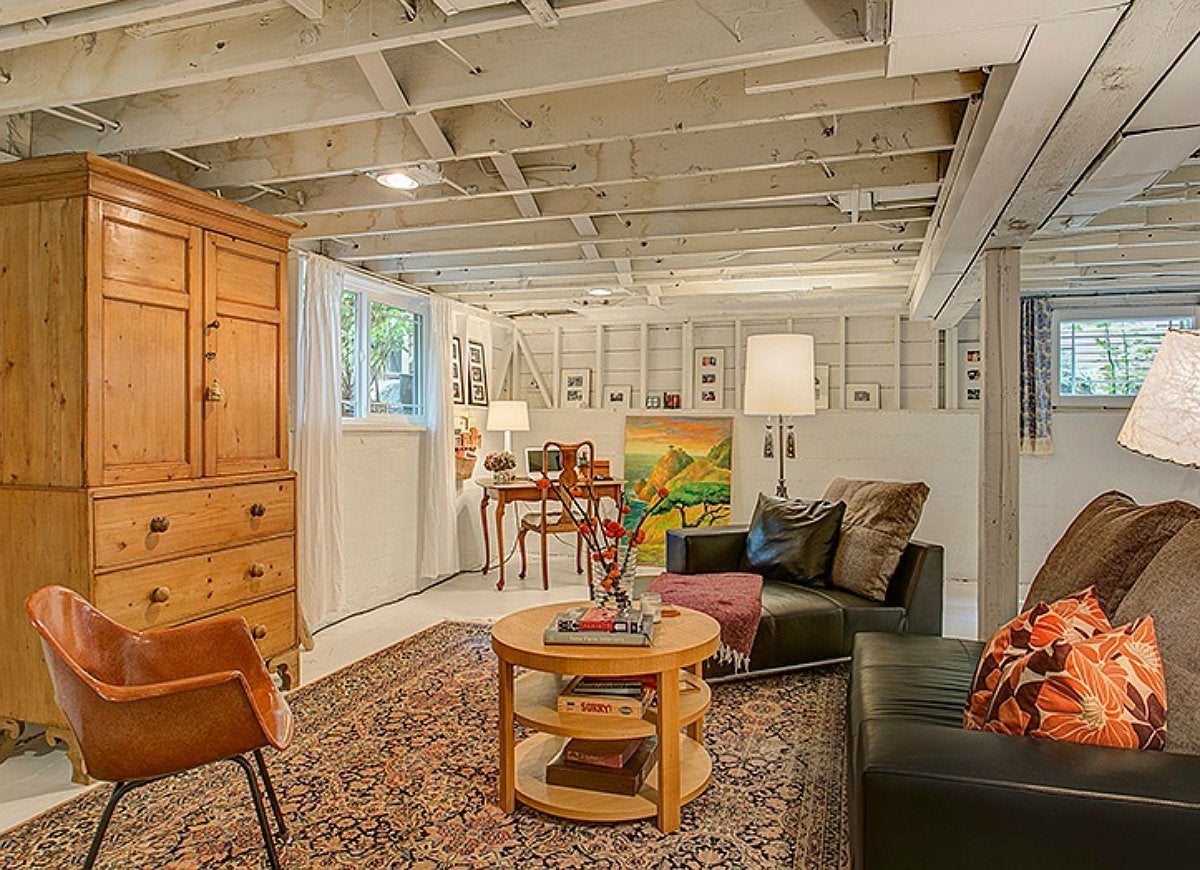 unfinished basement. Large spans of bare wall or empty areas beneath the stairs can make an unfinished  basement feel dark and dreary Promote a welcoming vibe conceal any Basement Design 10 Fast Fixes to Make it Less Scary Bob Vila