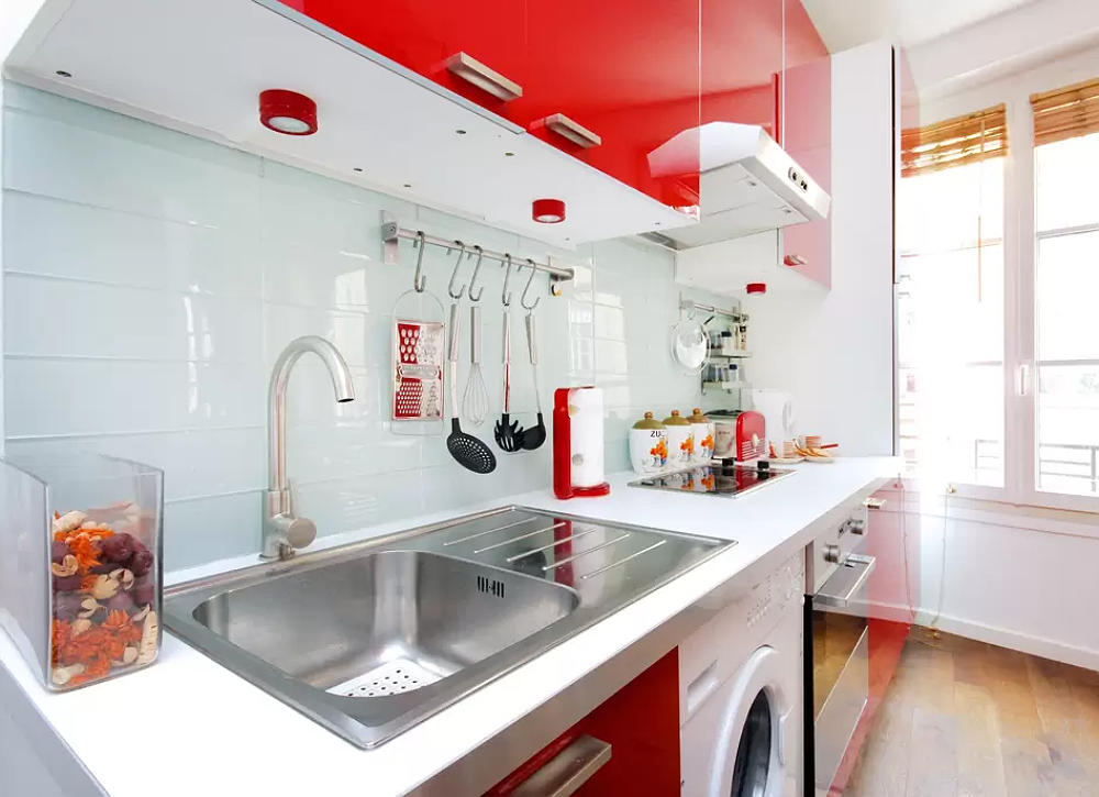 Tiny red kitchen and laundry room