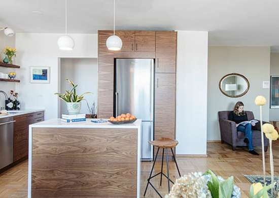 Small kitchen with built in storage around refrigerator
