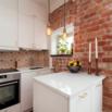 Tiny Corner Kitchen in Earth Tones