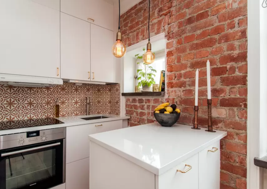 Corner kitchen exposed brick tile backspash