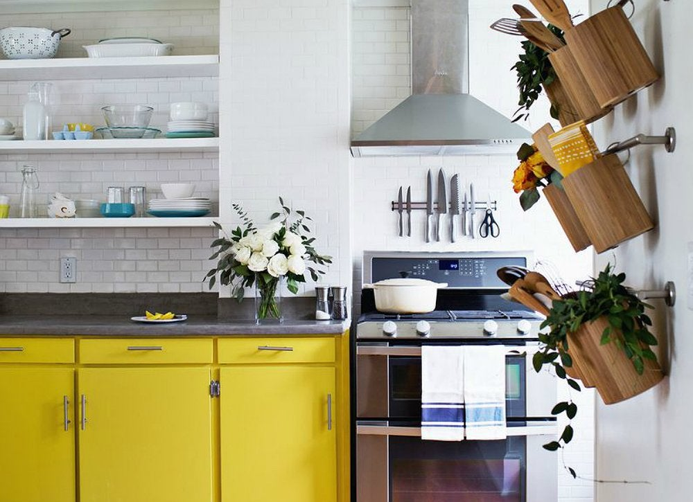 Small-kitchen-bright-yellow-cabinets-wall-storage
