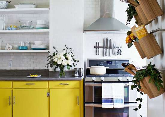 Small kitchen bright yellow cabinets wall storage