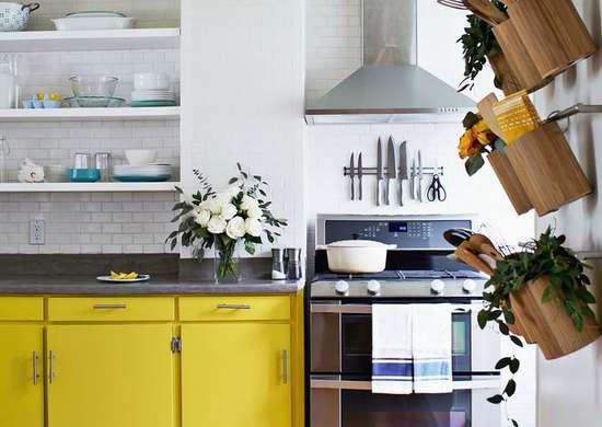 Small kitchen bright yellow cabinets wall storage