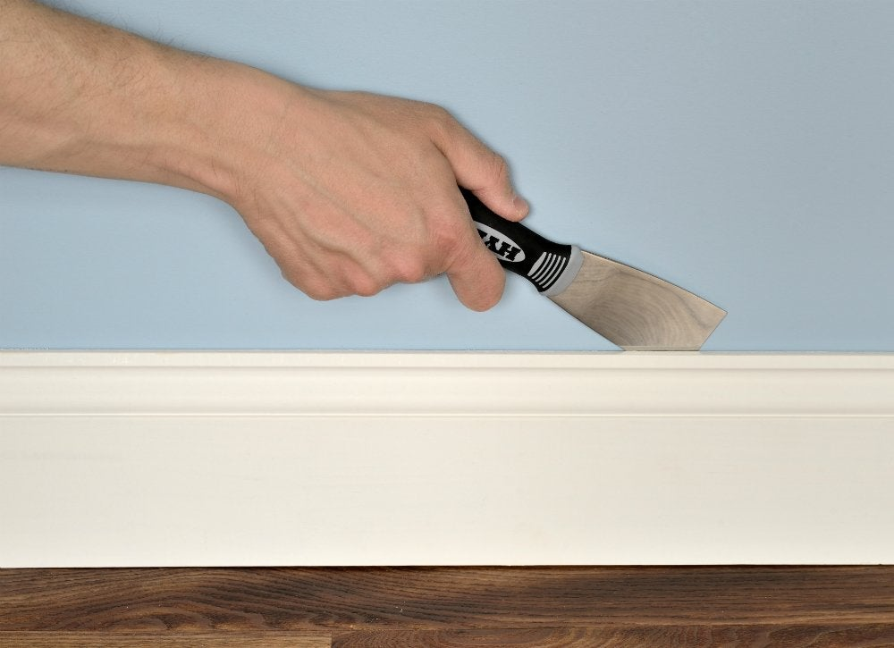 2inch putty knife removing baseboard