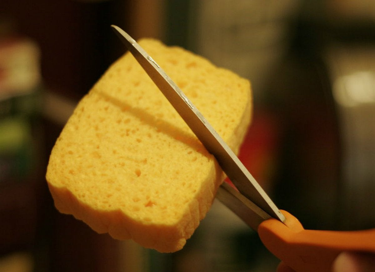 Cut-kitchen-sponges-in-half-to-save-money