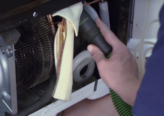 Vacuum refrigerator coils to save on electric bill
