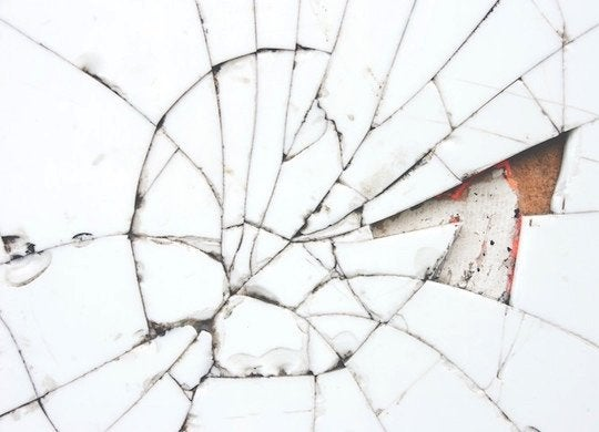 Construction adhesive tile repair