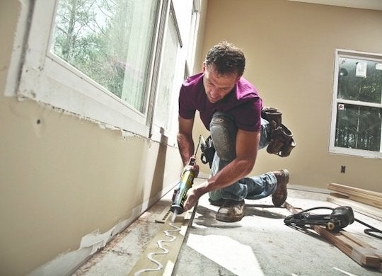 Construction adhesive baseboard