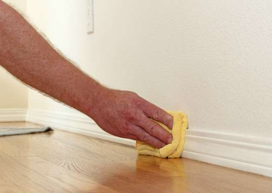 Dust Baseboards with Fabric Softener Sheets