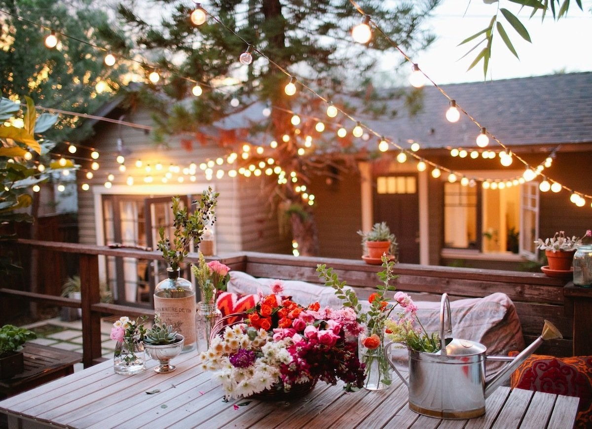 Unify separate backyard spaces with string lighting