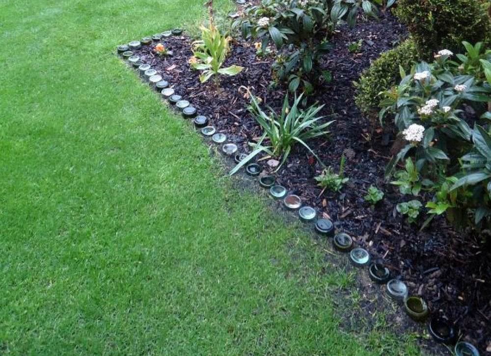 Diy wine bottle garden edging