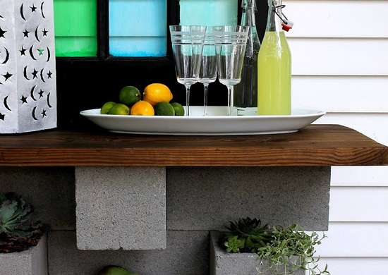 Diy wall mounted cinderblock bar and planter