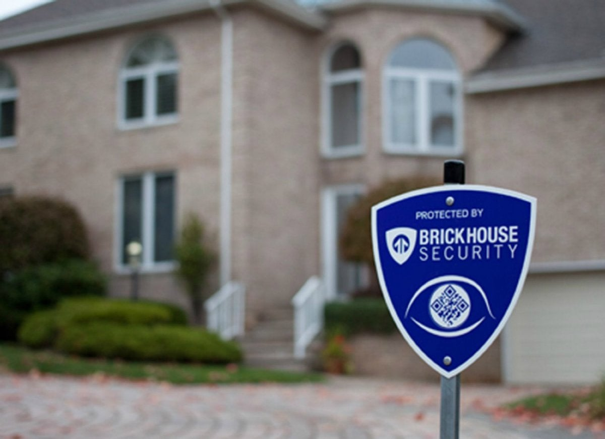 Brick house home security sign