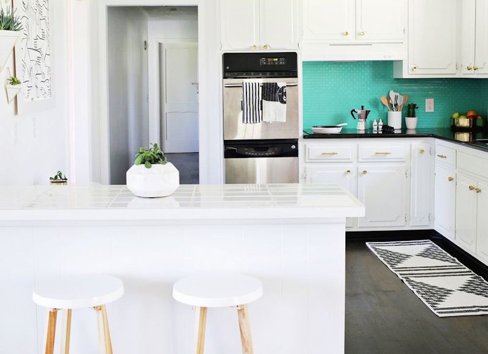 Teal and white kitchen