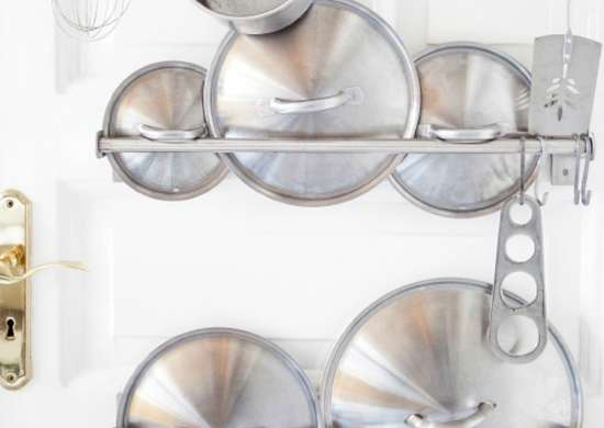 Store pots pans lids on door