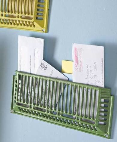 Apartmenttherapy repurposed metal grates for wall organization