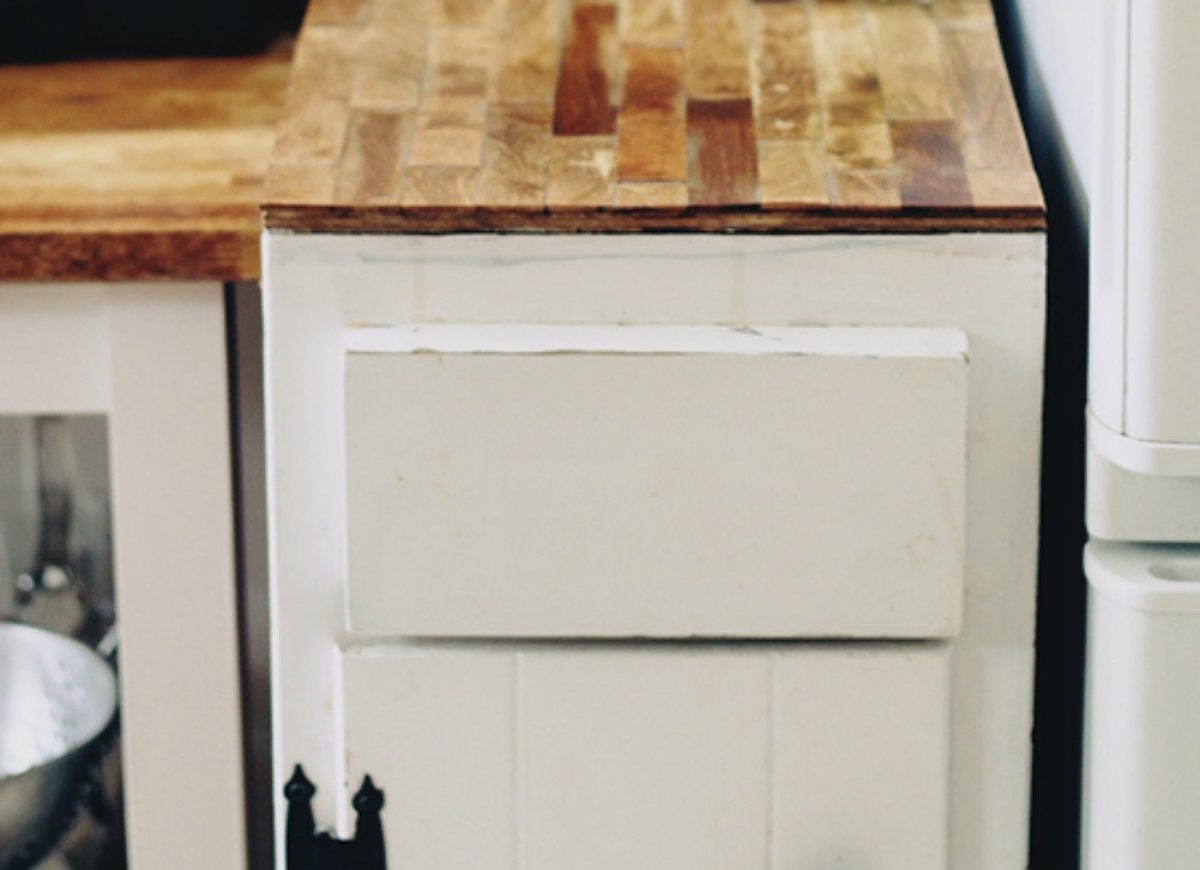 Diy kitchen countertop with paint stirrers 21 home hacks that are crazy enough to work bob vila - Diy faux butcher block countertops ...