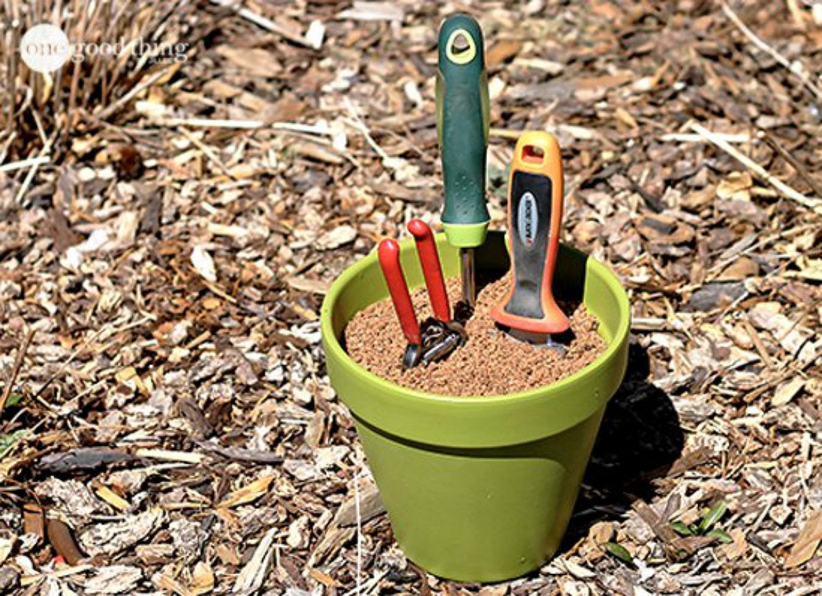 Prevent rust and sharpen garden tools with plant pot