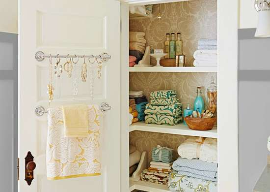 Towel curtain rod storage