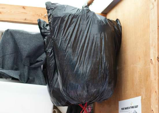 Pack Hanging Clothes in Garbage Bags