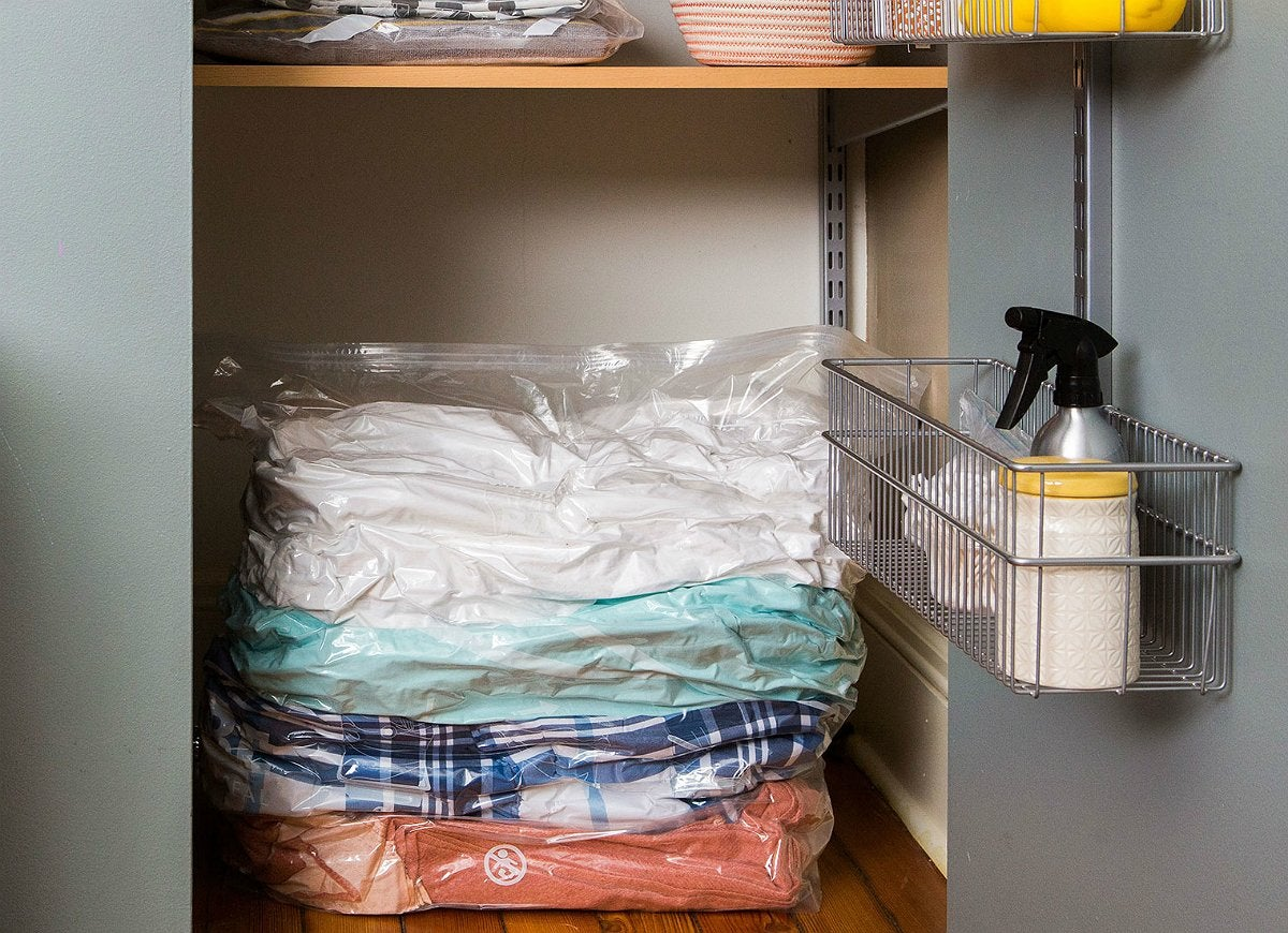 Vacuum seal clothes linens bedding to save space