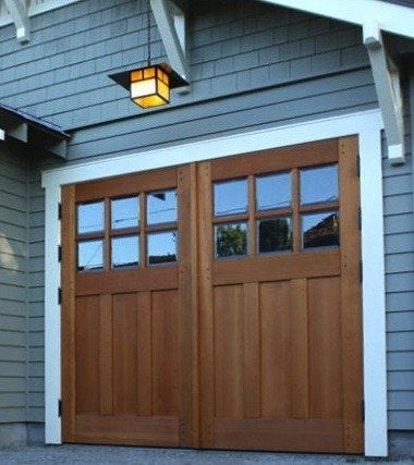 Garage doors 10 styles to boost curb appeal bob vila for Carriage type garage doors