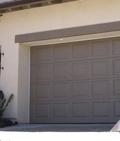 Garage doors 10 styles to boost curb appeal bob vila for Composite wood garage doors