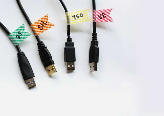Organize power cords with tape