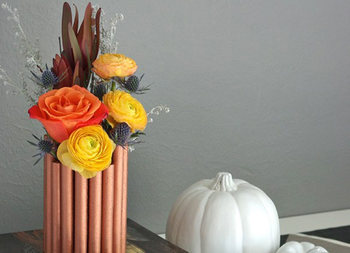 Faux copper pipe vase