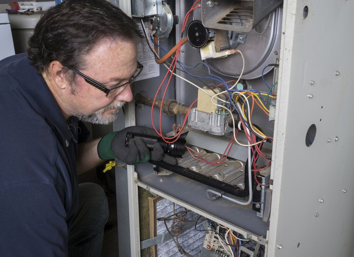 Technician_looking_at_a_furnace