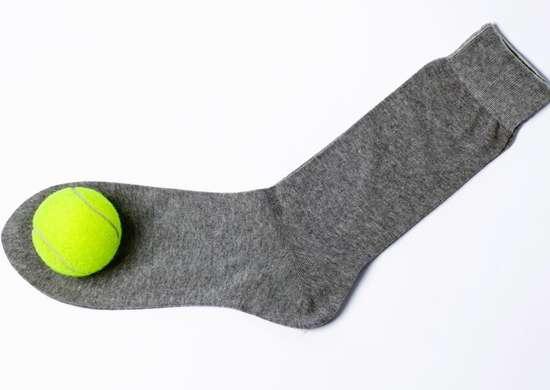 Tennis Ball and Sock in Dryer