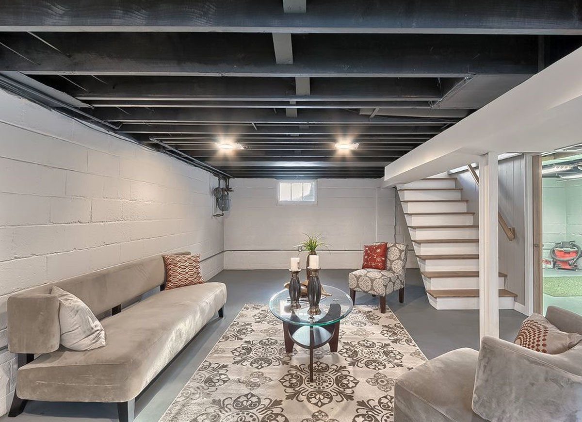 Unfinished basement ideas 9 affordable tips bob vila for Best way to build a basement