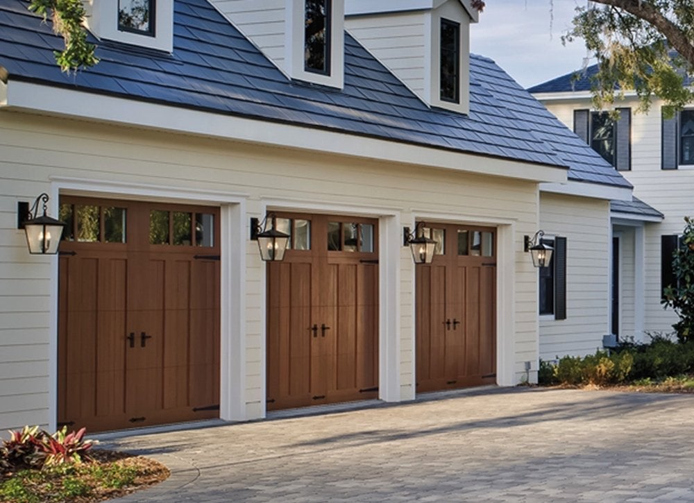 Low maintenance new garage door 7 features to look for for Wood looking garage doors