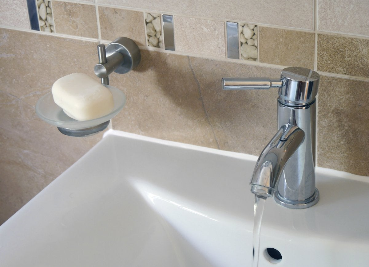 Wall-mounted-soap-dispenser-or-shelf