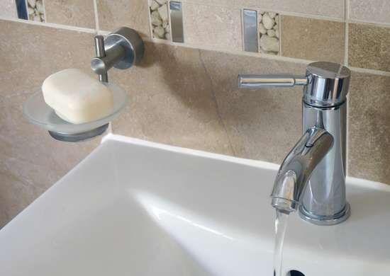 Wall mounted soap dispenser or shelf