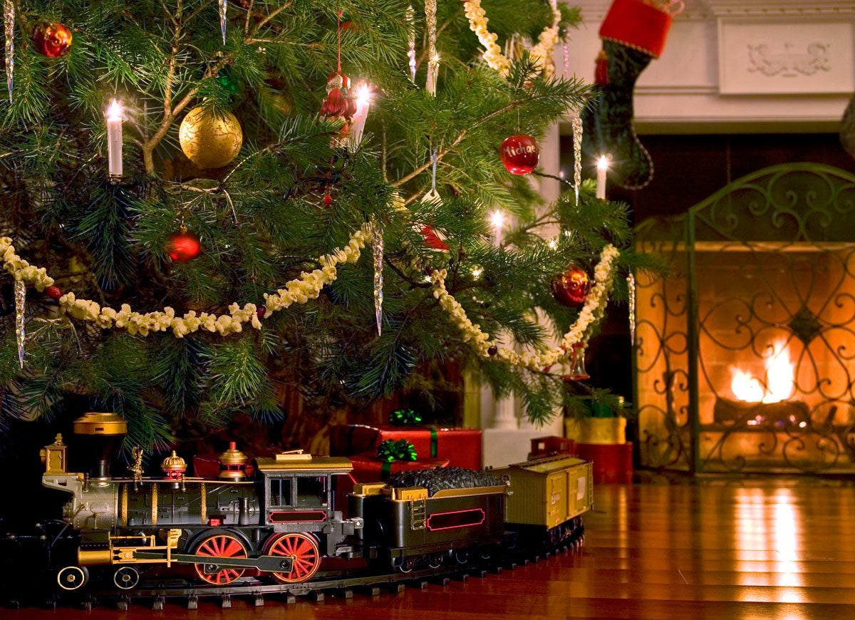 Christmas Train Sets Under Tree