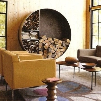 A Metal Bookcase Repurposed Here As Wood Storage Groups Together Logs Timber And Kindling To Create An Appealing Wall Art Effect
