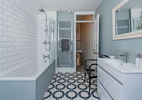 Bathroom with Patterned Floor Tile