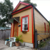 Shotgun House in Yellow and Red