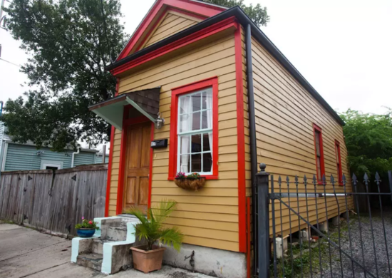Yellow and red shotgun house
